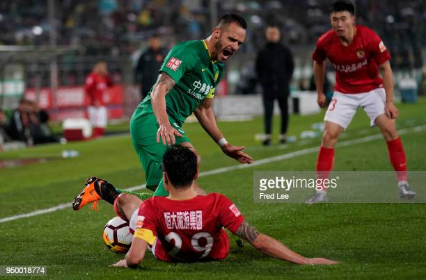 Renato Augusto of Beijing Guoan FC and Gao Lin of Guangzhou Evergrande Taobao fight for the ball during during 2018 China Super League match between...