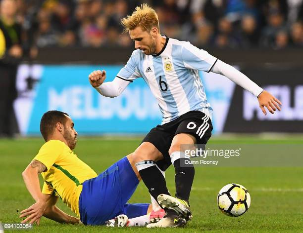 Renato Augusto of Brazil and Lucas Biglia of Argentina compete for the ball during the Brazil Global Tour match between Brazil and Argentina at...
