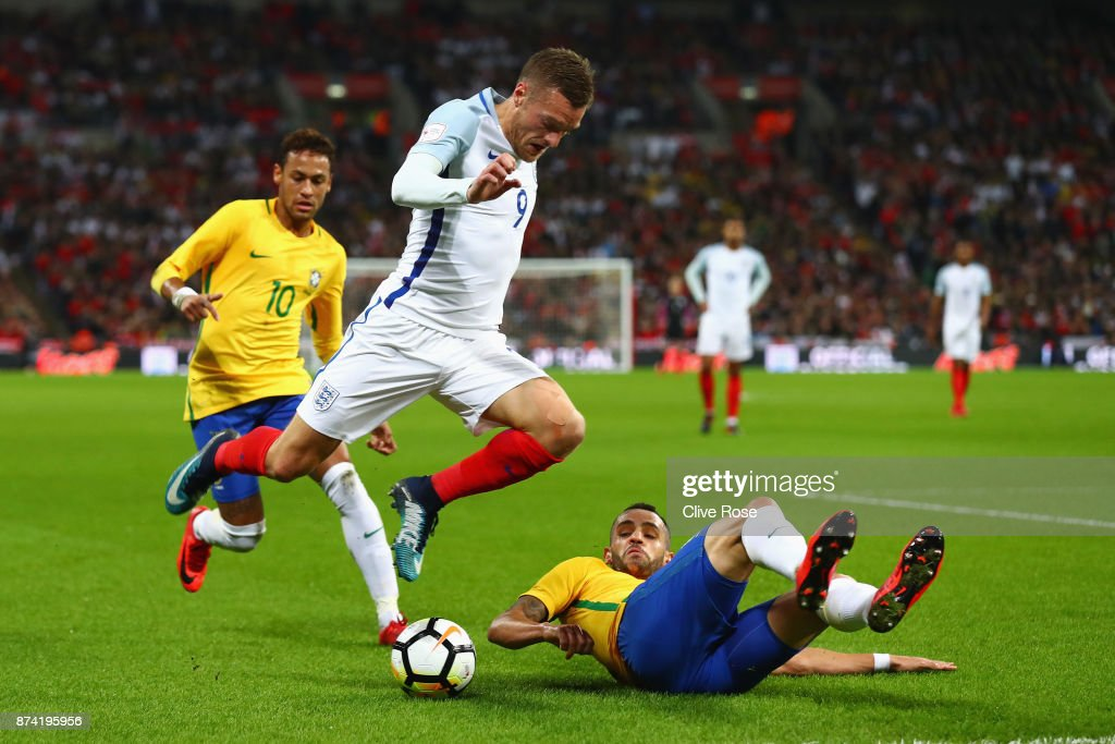 Renato Augusto of Brazil attempts to tackle Jamie Vardy of England during the international friendly match between England and Brazil at Wembley Stadium on November 14, 2017 in London, England.