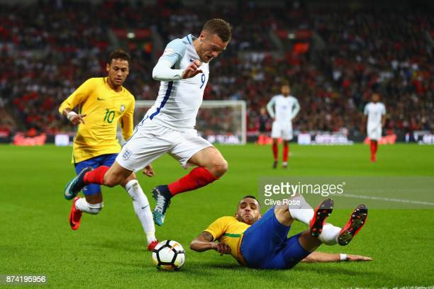Renato Augusto of Brazil attempts to tackle Jamie Vardy of England during the international friendly match between England and Brazil at Wembley...