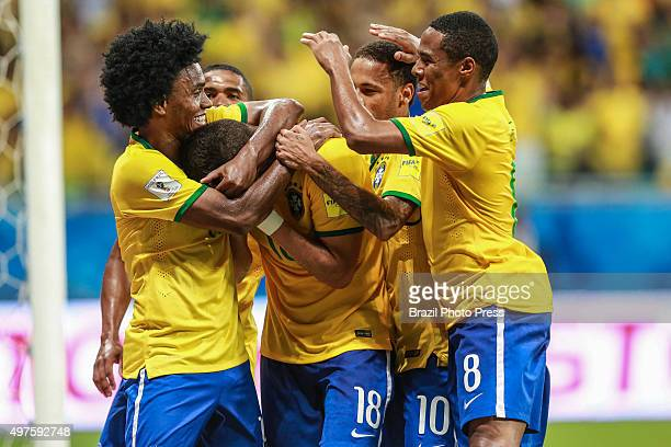 Renato Augusto of Brazil celebrates with teammates after scoring the second goal of his team during a match between Brazil and Peru as part of FIFA...
