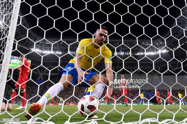 Renato Augusto of Brazil gathers the ball out the back of the net after scoring his sides first goal during the 2018 FIFA World Cup Russia Quarter...