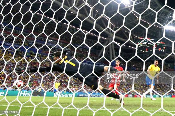 Renato Augusto of Brazil scores past Thibaut Courtois of Belgium his team's first goal during the 2018 FIFA World Cup Russia Quarter Final match...