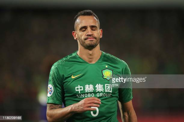 Renato Augusto of China's Beijing Guoan reacts during the AFC Champions League group stage football match between China's Beijing Guoan and Japan's...