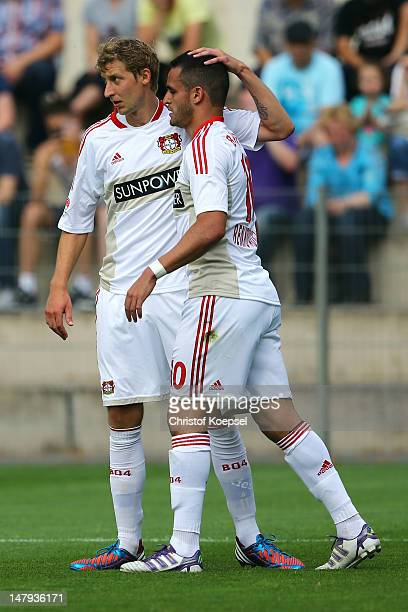 Renato Augusto of Leverkusen celebrates the second goal with Stefan Kiessling during the friendly match between Bayer Leverkusen and MSV Duisburg at...