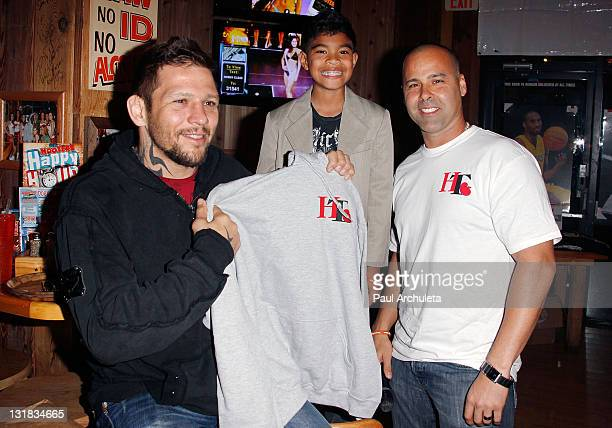 Renato Babalu Sobral Tyler Ransom and Bret Roberts attend the 'MMA Cares' holiday charity fundraiser for the Healing Tyler Foundation at Hooters on...