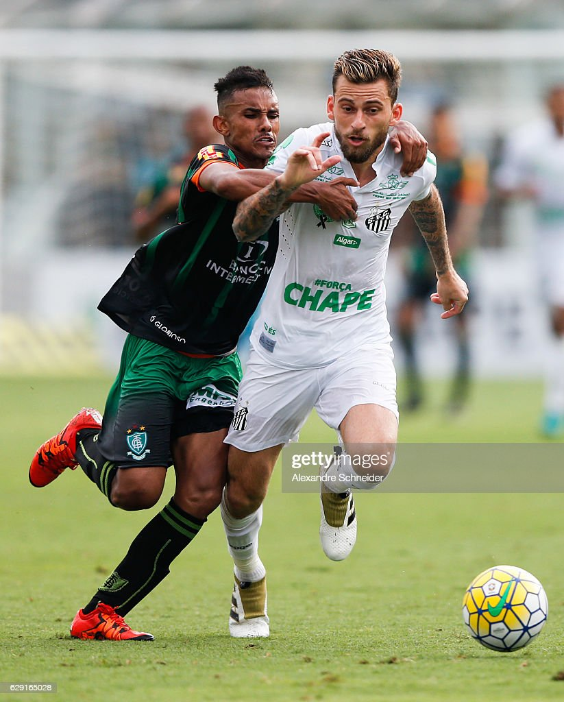 Renato Bruno (L) of America MG and Lucas Lima of Santos in action during the match between Santos and America MG for the Brazilian Series A 2016 at Vila Belmiro stadium on December 11, 2016 in Sao Paulo, Brazil.
