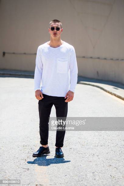 Renato Cela wears a white t-shirt and black pants during Pitti Immagine Uomo 92. At Fortezza Da Basso on June 15, 2017 in Florence, Italy.