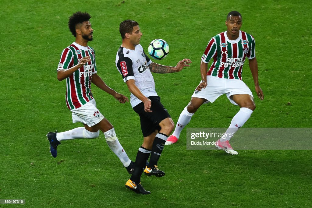 Renato Chaves (L) and Marlon Freitas of Fluminense struggle for the ball with Rafael Moura of Atletico MG during a match between Fluminense and Atletico MG part of Brasileirao Series A 2017 at Maracana Stadium on August 21, 2017 in Rio de Janeiro, Brazil.