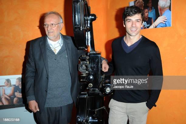 Renato Chiera and Luca Argentero attend 'Casa Do Menor L'altra Faccia Del Brasile' Milan Photocall on November 14 2013 in Milan Italy