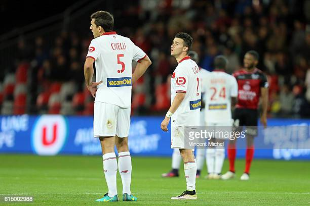 Renato Civelli and Sebastien Corchia of Lille during the Ligue 1 match between EA Guingamp and Lille OCS at Stade du Roudourou on October 15, 2016 in...