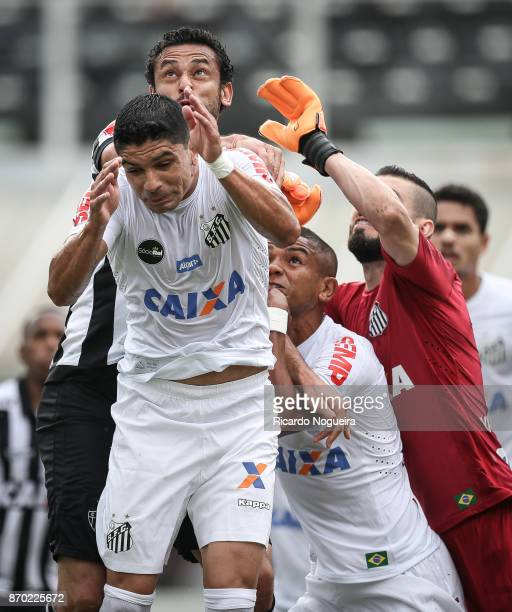 Renato David Braz and Vanderlei of Santos battles for the ball with Fred of Atletico Mineiro during the match between Santos and Atletico Mineiro as...