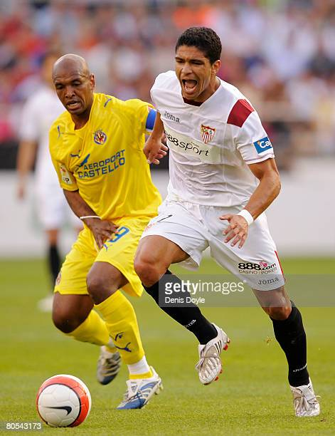 Renato Dirnei of Sevilla takes the ball from Marcos Senna of Villarreal during the La Liga match between Sevilla and Villarreal at the Sanchez...