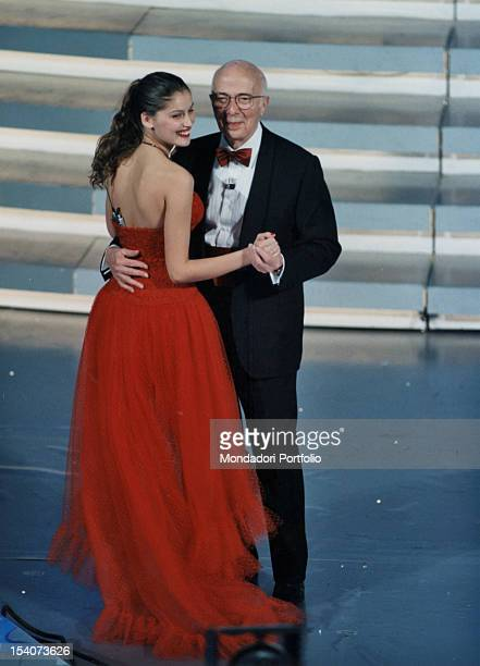 Renato Dulbecco Nobel Prize in Physiology or Medicine guest at the 49th Sanremo Music Festival dancing with French top model Laetitia Casta Sanremo...