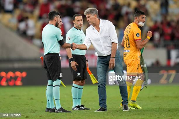 Renato Gaúcho head coach of Flamengo greets referees after winning a semi final first leg match between Flamengo and Barcelona SC as part of Copa...