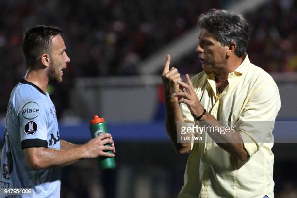Renato Gaucho coach of Gremio gives instructions to his player Arthur during a match between Cerro Porteño and Gremio as part of Copa CONMEBOL...