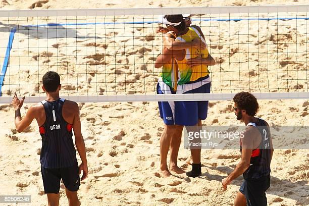 Renato Gomes and Jorge Terceiro of Georgia walks away as Emanuel Rego and Ricardo Santos of Brazil celebrate a point during the bronze medal beach...