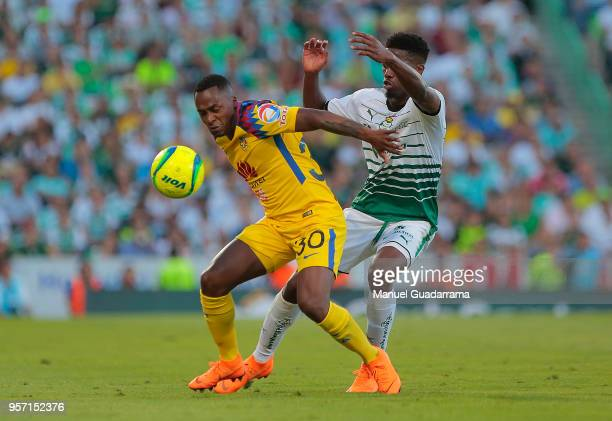 Renato Ibarra of America and Djaniny Tavares of Santos during the semifinals first leg match between Santos Laguna and America as part of the Torneo...