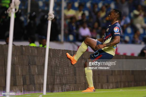 Renato Ibarra of America celebrates after scoring the first goal of his team during the 16th round match between Puebla and America as part of the...