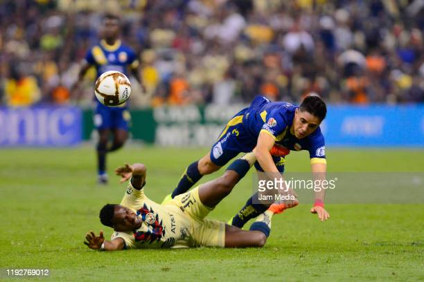 Renato Ibarra of America fights for the ball with Efrain Velarde of Morelia during the Semifinals second leg match between America and Morelia as...