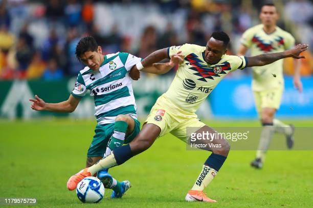Renato Ibarra of America struggles for the ball with Gerardo Arteaga of Santos Laguna during the 17th round match between America and Santos Laguna...