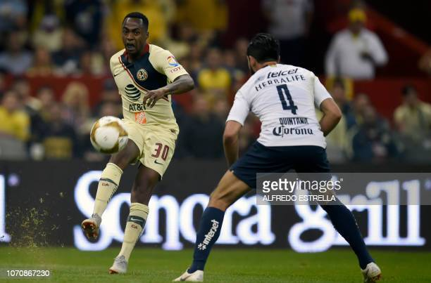 Renato Ibarra of America vies for the ball with Fernando Quintana of Pumas during the second round of semifinals of the Mexican Apertura tournament...