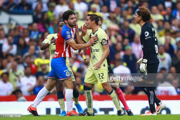 Renato Ibarra Paul Aguilar and Guillermo Ochoa of America argue with Antonio Briseno of Chivas after a foul against Giovani Dos Santos of America...