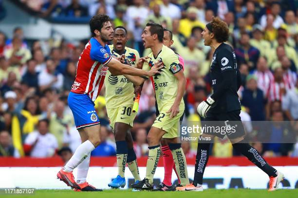 Renato Ibarra, Paul Aguilar and Guillermo Ochoa of America argues with Antonio Briseno of Chivas after a foul against Giovani Dos Santos of America...