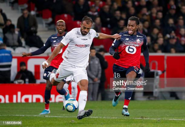 Renato Jr Luz Sanches of Losc challenges Vitorino Hilton of Montpellier Herault SC during the Ligue 1 match between Lille OSC and Montpellier HSC at...