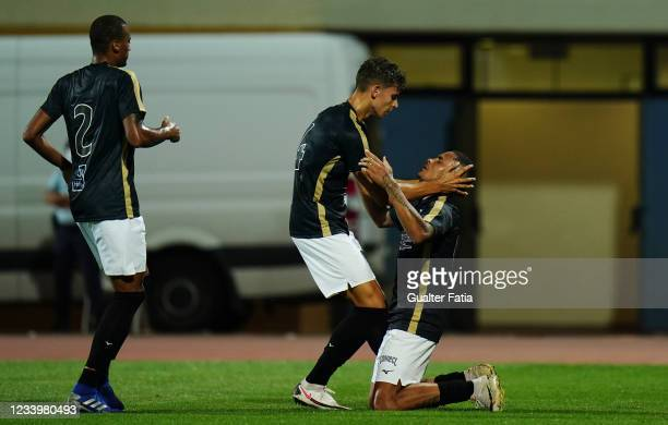 Renato Jr. Of Portimonense SC celebrates with teammates after scoring a goal during the Pre-Season Friendly match between Sporting CP and...