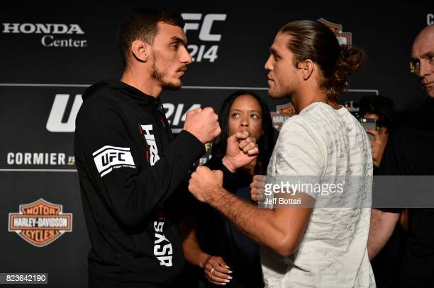 Renato Moicano of Brazil and Brian Ortega face off for the media during the UFC 214 Ultimate Media Day at UFC GYM La Mirada on July 27 2017 in La...