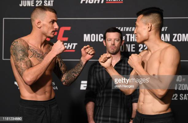 Renato Moicano of Brazil and Chan Sung Jung of South Korea face off during the UFC Fight Night weighin at the Hyatt Regency Greenville on June 21...