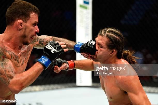 Renato Moicano of Brazil lands a punch against Brian Ortega in their featherweight bout during the UFC 214 event at Honda Center on July 29 2017 in...