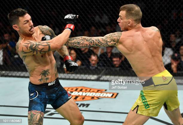 Renato Moicano of Brazil punches Cub Swanson in their featherweight fight during the UFC 227 event inside Staples Center on August 4 2018 in Los...