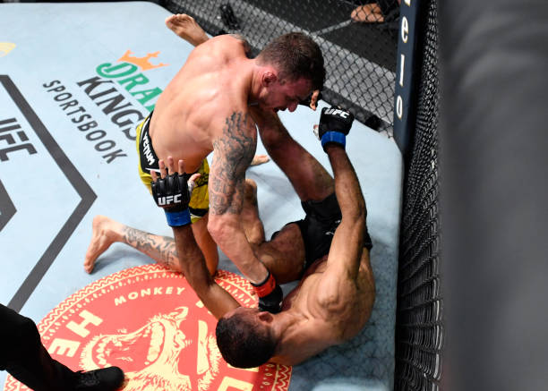 Renato Moicano of Brazil punches Jai Herbert of England in a lightweight fight during the UFC Fight Night event at UFC APEX on June 26, 2021 in Las...