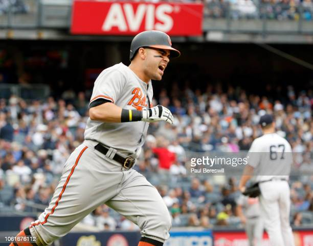 Renato Nunez of the Baltimore Orioles runs the bases celebrating his home run against pitcher AJ Cole in an MLB baseball game against the New York...