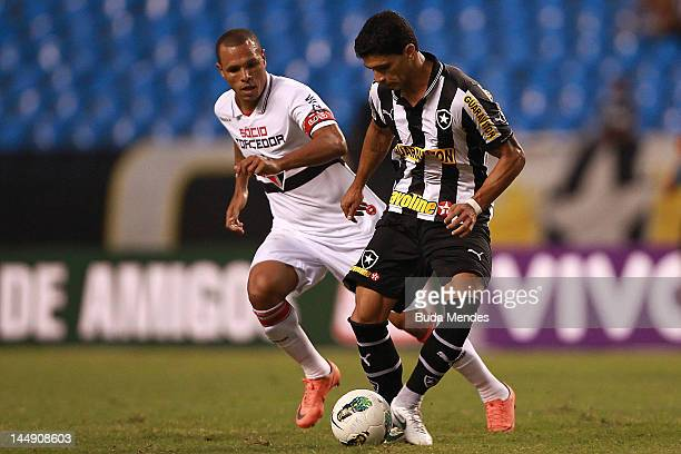 Renato of Botafogo struggles for the ball with Luis Fabiano of Sao Paulo during a match between Sao Paulo and Botafogo as part of Serie A 2012 at...
