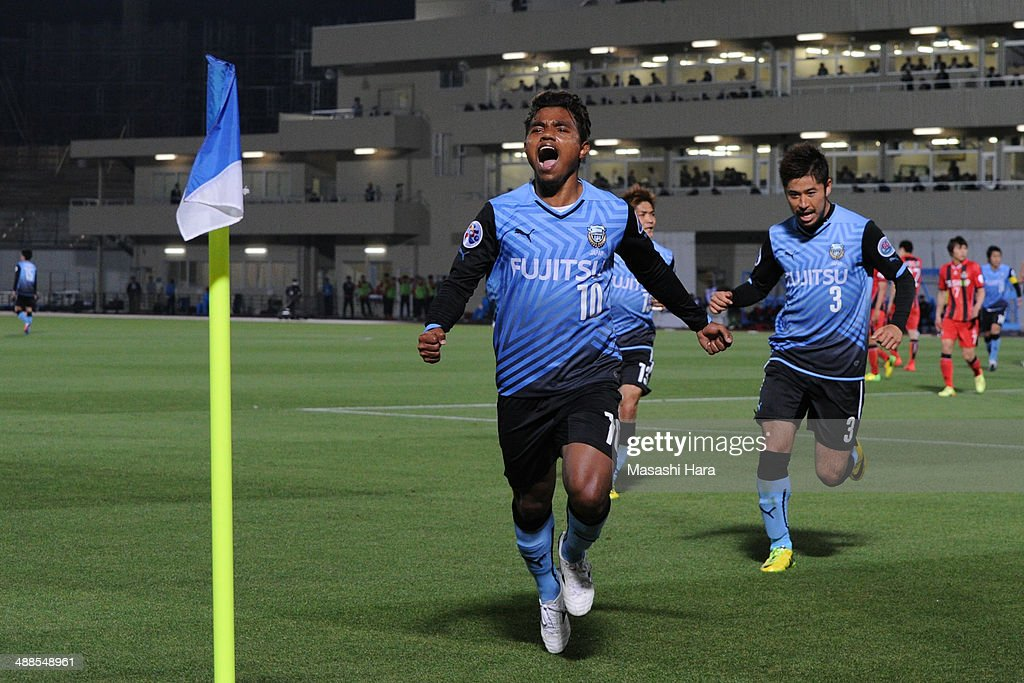 Renato #10 of Kawasaki Frontale celebrates the second goal during the AFC Champions League Round of 16 match between Kawasaki Frontale and FC Seoul at Todoroki Stadium on May 7, 2014 in Kawasaki, Japan.