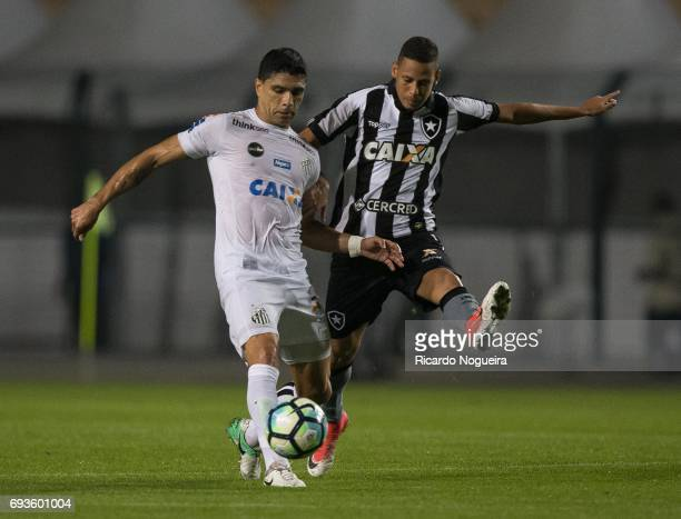 Renato of Santos battles for the ball with Matheus Fernandes 11# of Botafogo during the match between Santos and Botafogo as a part of Campeonato...