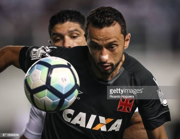 Renato of Santos battles for the ball with Nene of Vasco during the match between Santos and Vasco da Gama as a part of Campeonato Brasileiro 2017 at...
