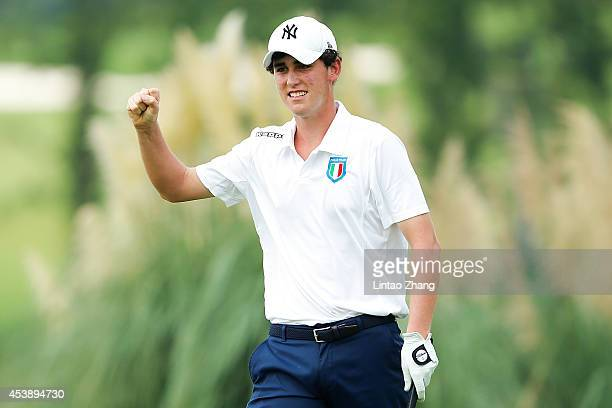 Renato Paratore of Italy celebrates after chipping in for an eagle on the 17th hole during the Men's Individual Stroke Play on day five of the...