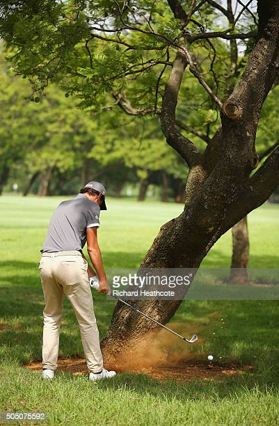 Renato Paratore of Italy plays a lefthanded shot from behind a tree on the 9th hole on the West Course during day two of the Joburg Open at Royal...