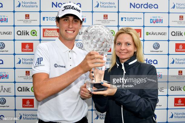 Renato Paratore of Italy poses with the trophy and Anna Storaker after his victory during day four of the Nordea Masters at Barseback Golf Country...