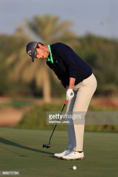 Renato Paratore of Italy putts on the first green during round one of the Abu Dhabi HSBC Golf Championship at Abu Dhabi Golf Club on January 18 2018...