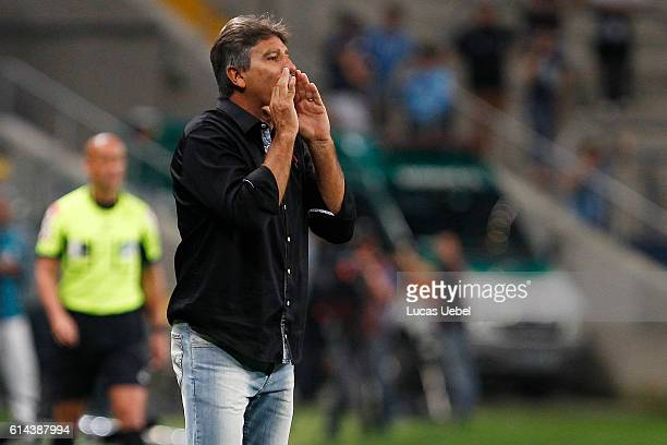 Renato Portaluppi coach of Gremio battles for the ball against Renan Lodi of AtleticoPR during the match Gremio v AtleticoPR as part of Brasileirao...