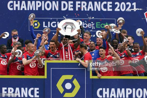 Renato Sanches and players of Lille OSC celebrate their League 1 championship by receiving the Champions Trophy at training center of Luchin near...