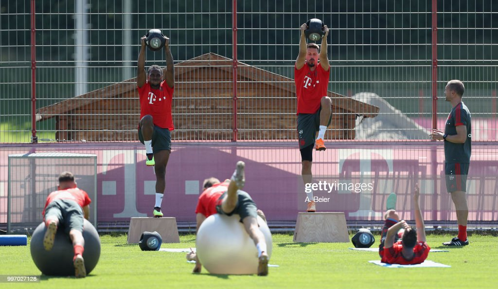 Renato Sanches (L) and Sandro Wagner of FC Bayern Muenchen practice during a training session at the club's Saebener Strasse training ground on July 12, 2018 in Munich, Germany.