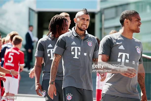 Renato Sanches Arturo Vidal and Douglas Costa of FC Bayern arrive for the Audi car handover at Audi Forum on August 22 2016 in Ingolstadt Germany