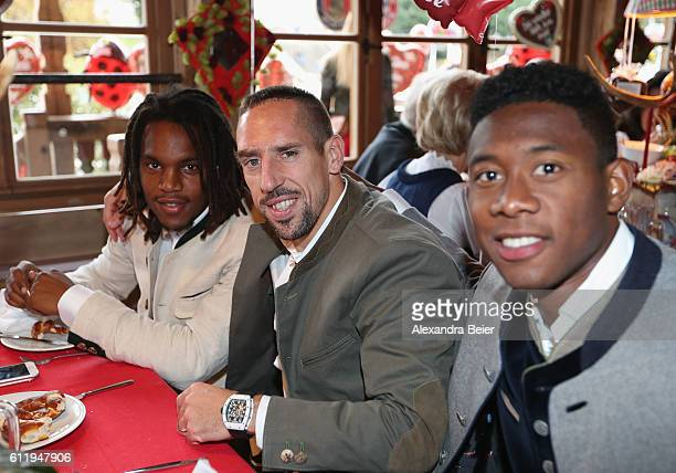 Renato Sanches Franck Ribery and David Alaba of FC Bayern Muenchen attend the Oktoberfest beer festival at Kaefer Wiesenschaenke tent at...