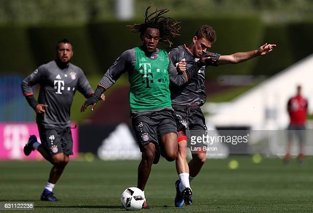 Renato Sanches is challenged by Joshua Kimmich during a training session at day 5 of the Bayern Muenchen training camp at Aspire Academy on January 7...